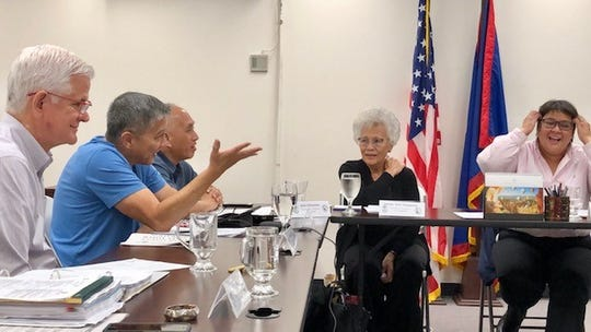 """Newly elected Guam Election Commission chairman Michael J. Perez of the Republican Party, second from left, gestures as he addresses fellow commissioners during Thursday night's meeting. Former commission chairwoman Alice Taijeron of the Democratic Party, right, is now the vice chairwoman. Also in photo are Commission Independent member Attorney Patrick Civille, and Republicans Jerry Crisostomo and Antonia """"Toni"""" Gumataotao."""