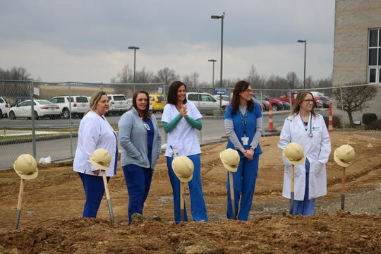 Employees of Methodist Hospital line up for a photo op after the breaking ground ceremony.