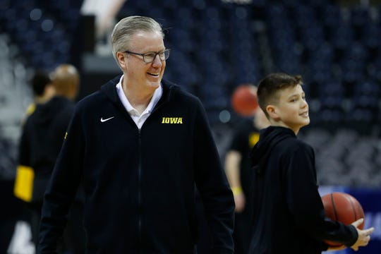 Iowa coach Fran McCaffery oversees practice Thursday at Nationwide Arena in downtown Columbus. (Note: That's McCaffery's youngest son, Jack, to the right.)