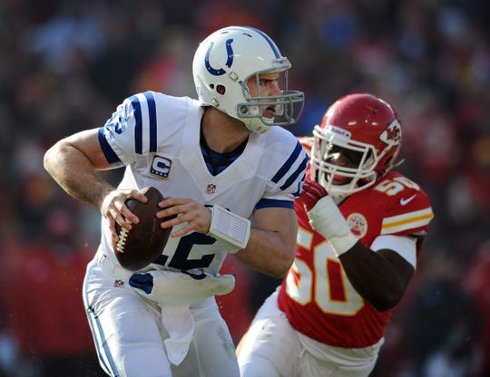 Indianapolis Colts QB Andrew Luck scrambled away from the threat of Kansas City Chiefs linebacker Justin Houston (50).
