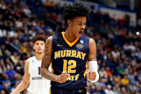 Murray State Racers guard Ja Morant (12) reacts after a score against the Marquette Golden Eagles during the first half of a game in the first round of the 2019 NCAA Tournament at XL Center.