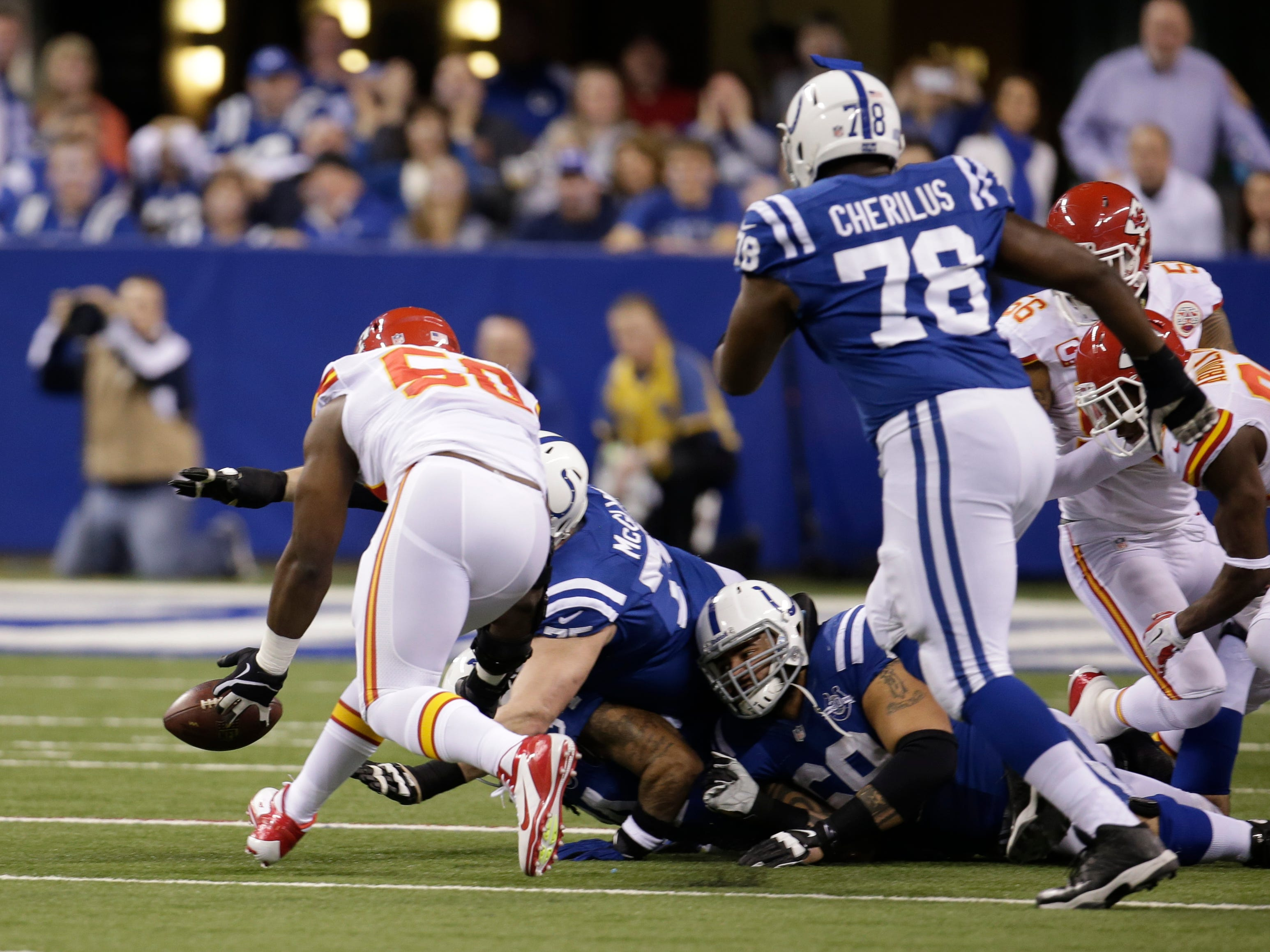 Kansas City Chiefs outside linebacker Justin Houston (50) recovered a fumble during the first half of an NFL wild-card playoff football game against the Indianapolis Colts on Jan. 4, 2014, in Indianapolis. (AP Photo/AJ Mast)