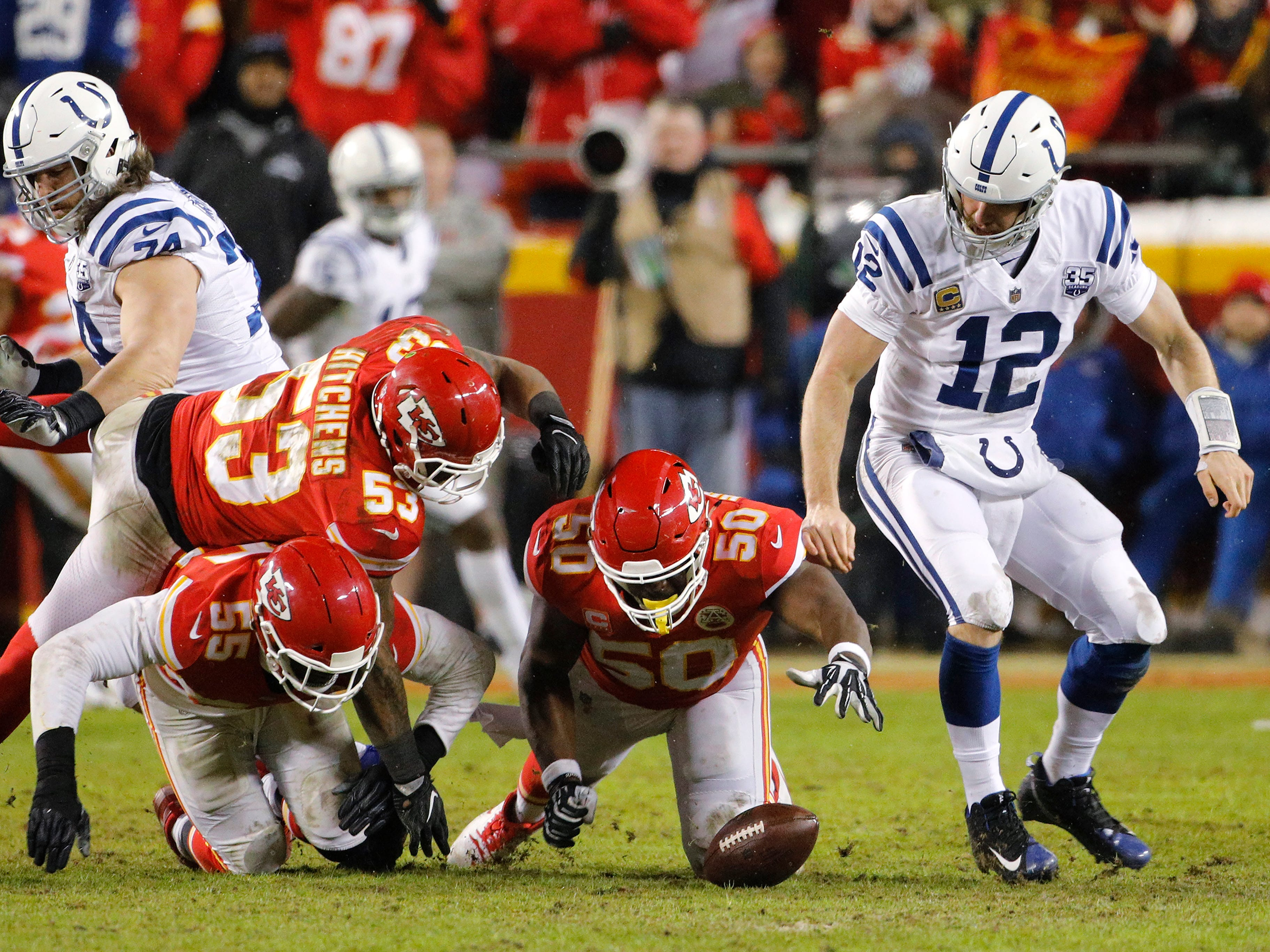 Kansas City Chiefs linebackers Anthony Hitchens (53), Dee Ford (55) and Justin Houston (50) go after a fumble by Indianapolis Colts quarterback Andrew Luck (12) during an AFC divisional NFL football game at Arrowhead Stadium in Kansas City, Mo., Saturday, Jan. 12, 2019. The fumble ended a Colts' drive in Chiefs territory.