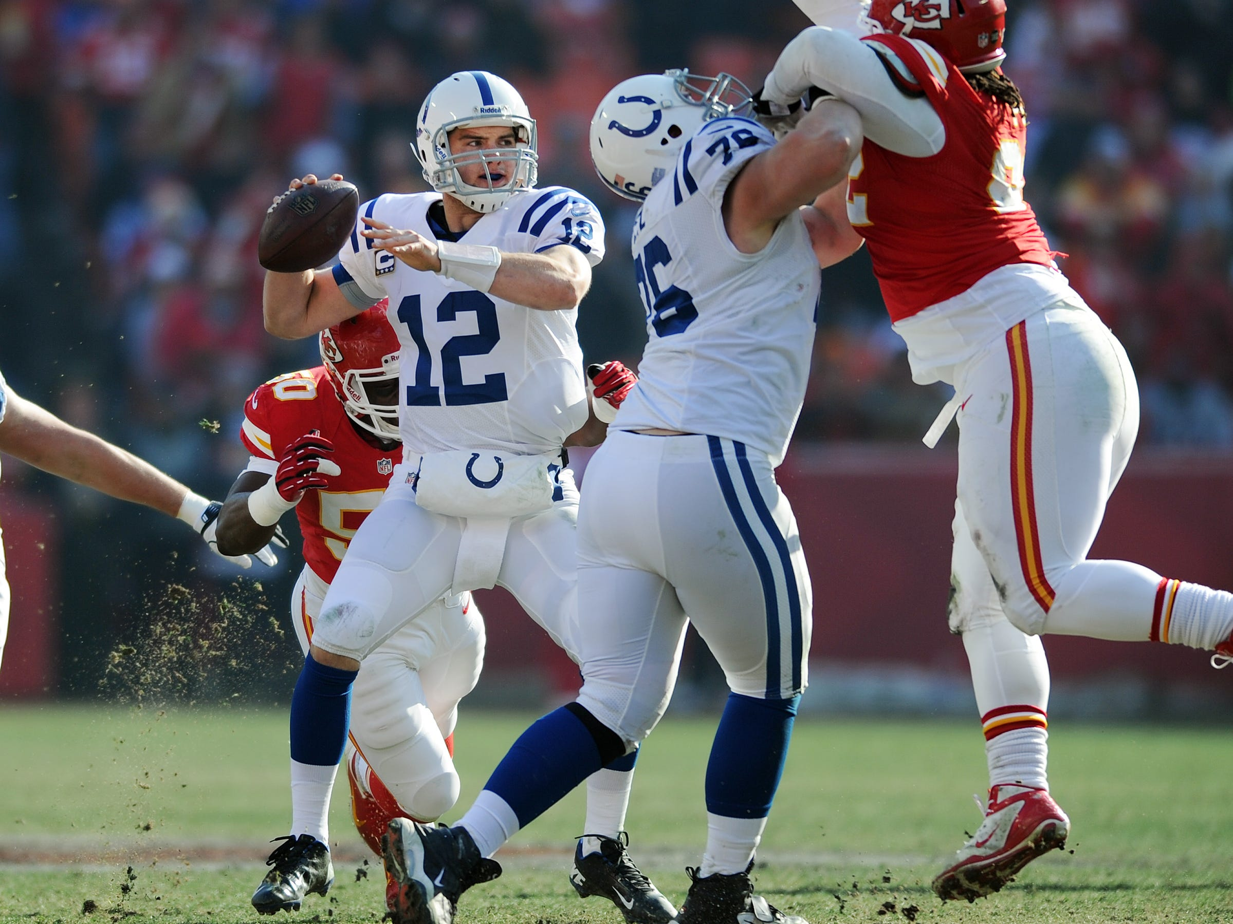 Indianapolis Colts QB Andrew Luck looks to pass as Kansas City Chiefs Justin Houston, left, pressures him in a game  at Arrowhead Stadium in Kansas City. The Colts defeated the Chiefs 20-13. Matt Kryger / The Star