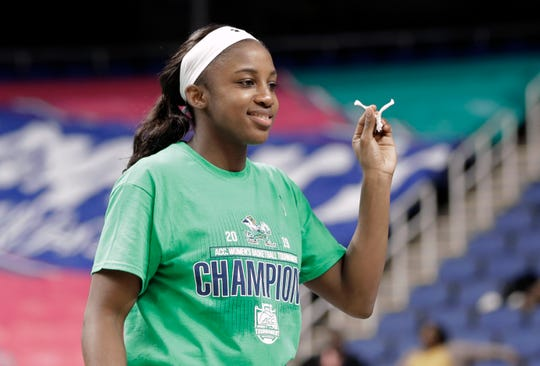 Notre Dame's Jackie Young (5) holds a piece of the net after her team defeated Louisville in the championship of the Atlantic Coast Conference women's tournament in Greensboro, N.C., Sunday, March 10, 2019. Young was named the tournament's MVP.