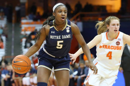 Notre Dame Fighting Irish guard Jackie Young (5) drives to the basket past Syracuse Orange guard Tiana Mangakahia (4) during the second half at the Carrier Dome.