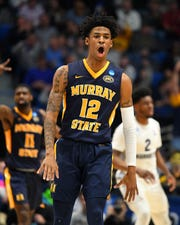 Murray State Racers guard Ja Morant (12) reacts to a score against the Marquette Golden Eagles during the first half in the first round of the 2019 NCAA Tournament at XL Center.