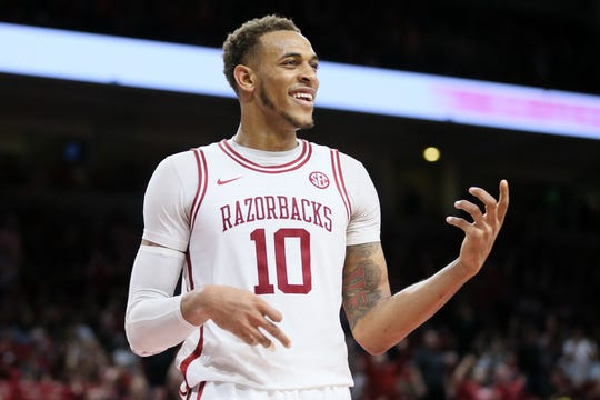 Razorbacks forward Daniel Gafford (10) celebrates by playing air guitar during the game against the Alabama Crimson Tide at Bud Walton Arena. Arkansas won 82-70.