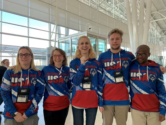 A team of Special Olympics Indiana athletes left March 10 for the World Games in Abu Dhabi. From left, Heather Zwingelberg, cycling coach Cindi Hart, Katie Crawford, Jerritt Covington and Andrew Peterson.