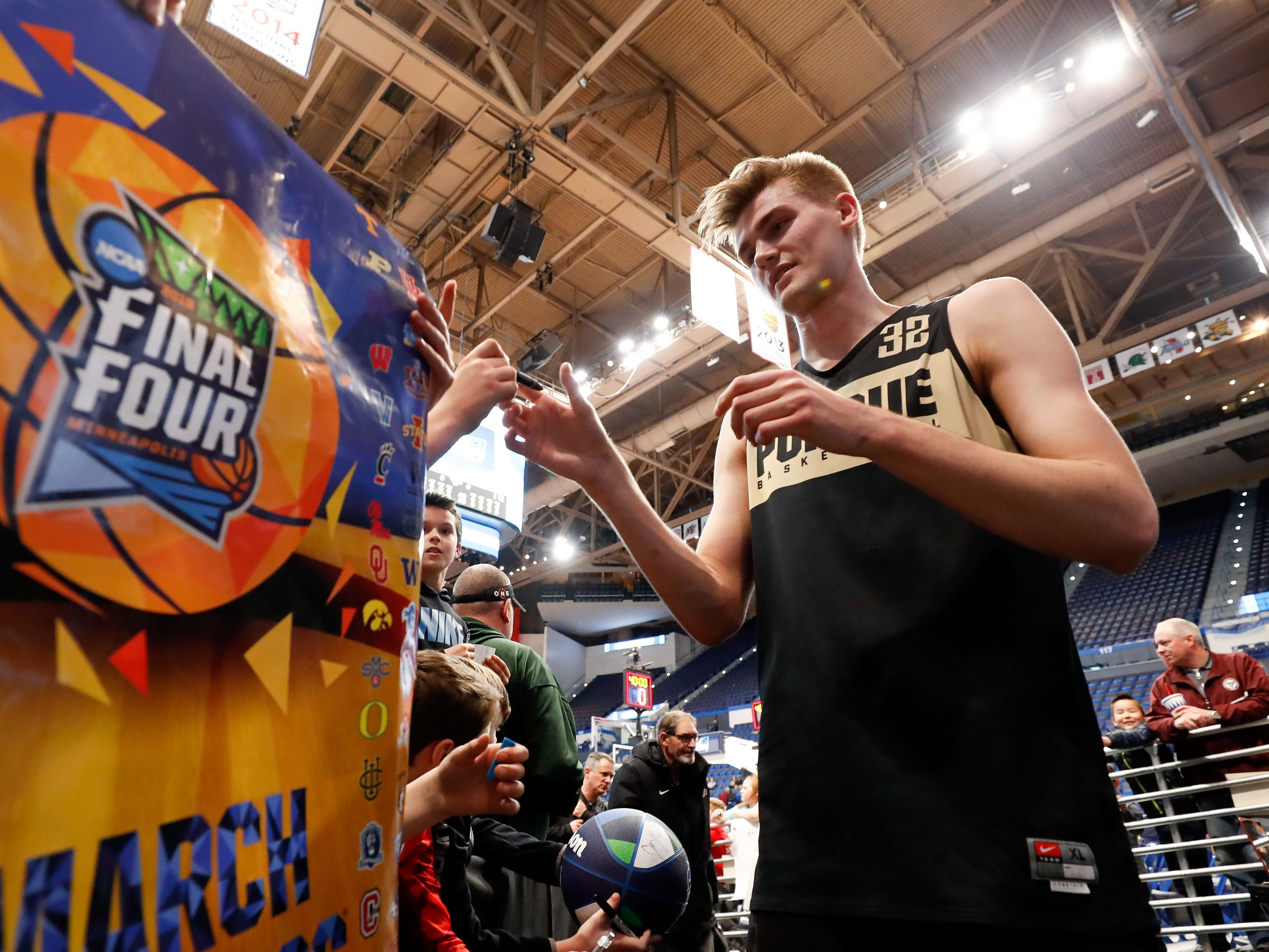 Mar 20, 2019; Hartford, CT, USA; Purdue Boilermakers center Matt Haarms (32) signs an autograph for fans during practice before the first round of the 2019 NCAA Tournament at XL Center.