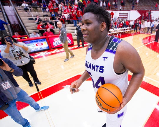 Ben Davis senior Dawand Jones (54) after defeating New Palestine in the Class 4A regional final, March 9, 2019.