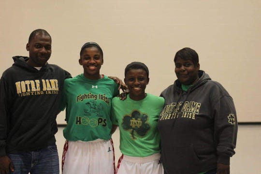 Notre Dame guard Jackie Young (second from left) with (l-r) brother Terrence Young, sister Kiare Young and mother Linda Young