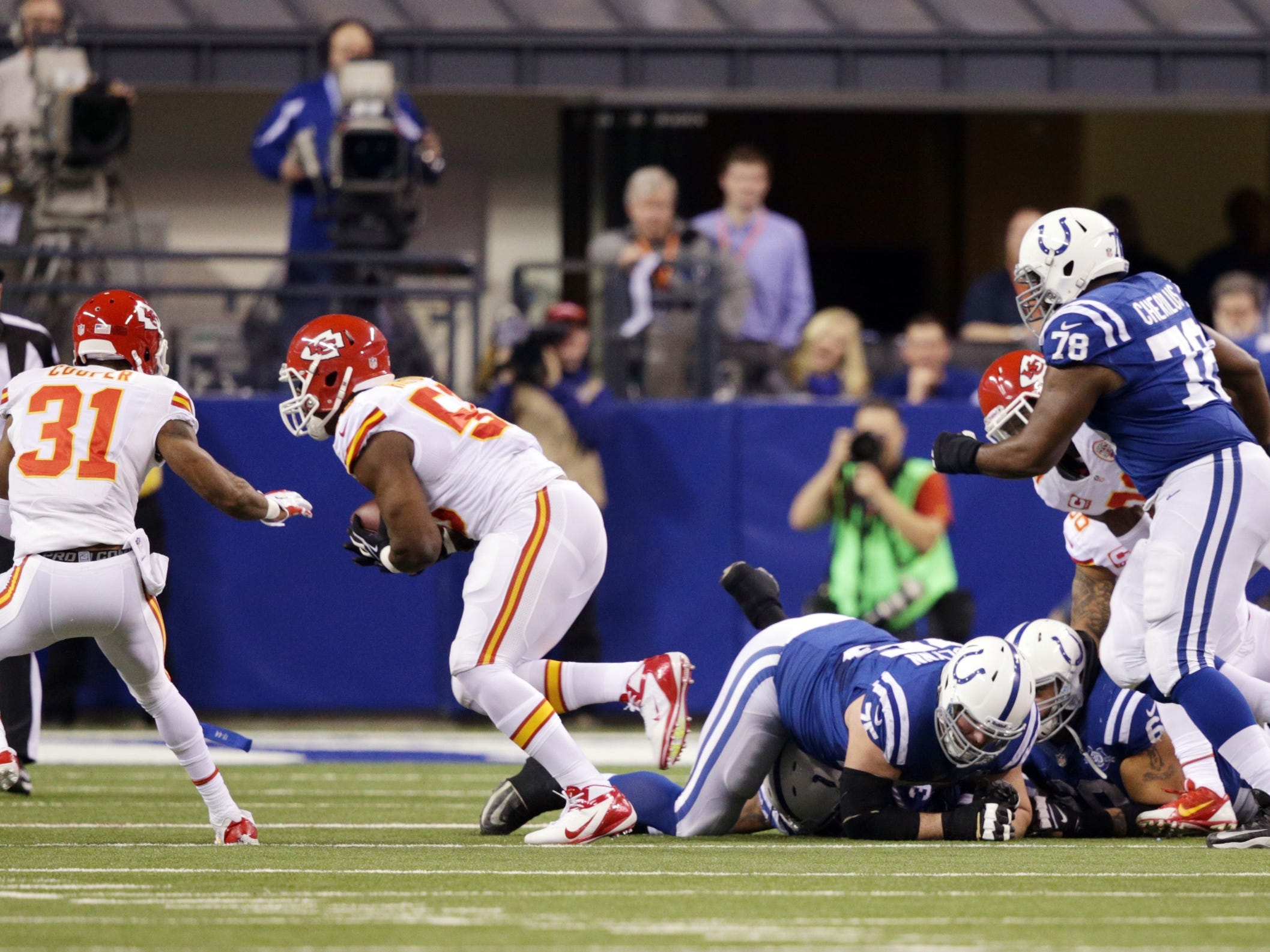 Kansas City Chiefs Justin Houston recovered a fumble during the first round of the NFL playoffs at Lucas Oil Stadium on Jan. 4, 2014.