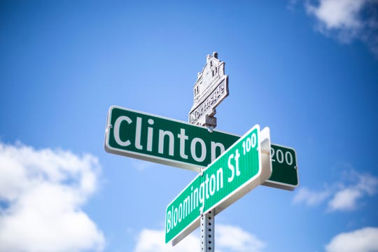 A placard for the Northside District above the intersection of Clinton and Bloomington Streets, Thursday, March 21, 2019, along Clinton Street in Iowa City, Iowa.