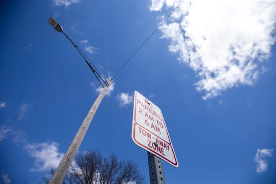 A parking sign on Thursday, March 21, 2019, along Clinton Street in Iowa City, Iowa.