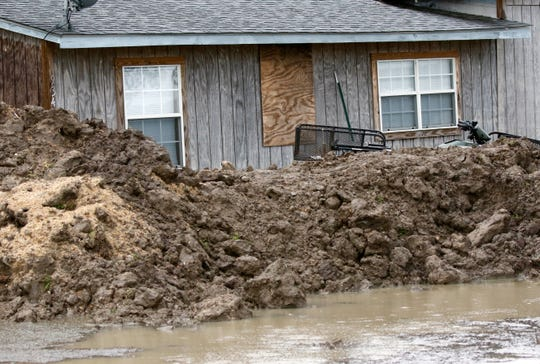 This March 11, 2019 photo shows a makeshift levee built by a resident in Rolling Fork, Miss., to protect his home from flood waters. In March 2019, scientists are warning that historic flooding could soon deluge parts of several southern states along the lower Mississippi River, where flood waters could persist for several weeks.