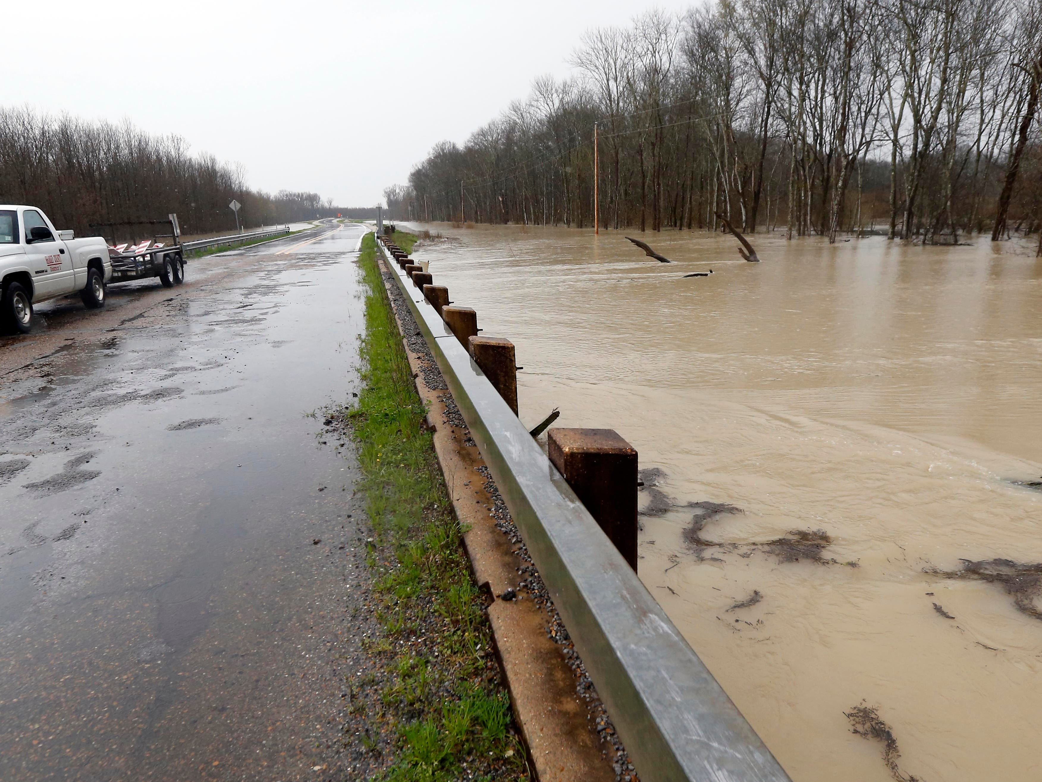 Backflow waters flood Mississippi 16 near Rolling Fork, Miss., Monday, March 11, 2019.