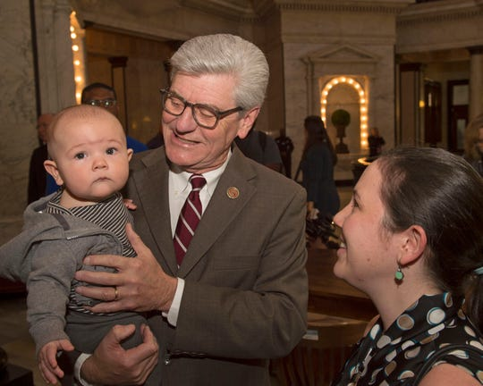 Gov. Phil Bryant holds Locke Baker, son of Anja Baker (right). Baker is community relations coordinator for the Center for Pregnancy Choices, in Jackson, and came to see Bryant's signing of abortion ban legislation into law. It makes abortions performed following the detection of a fetal heartbeat illegal. Thursday, March 21, 2019.