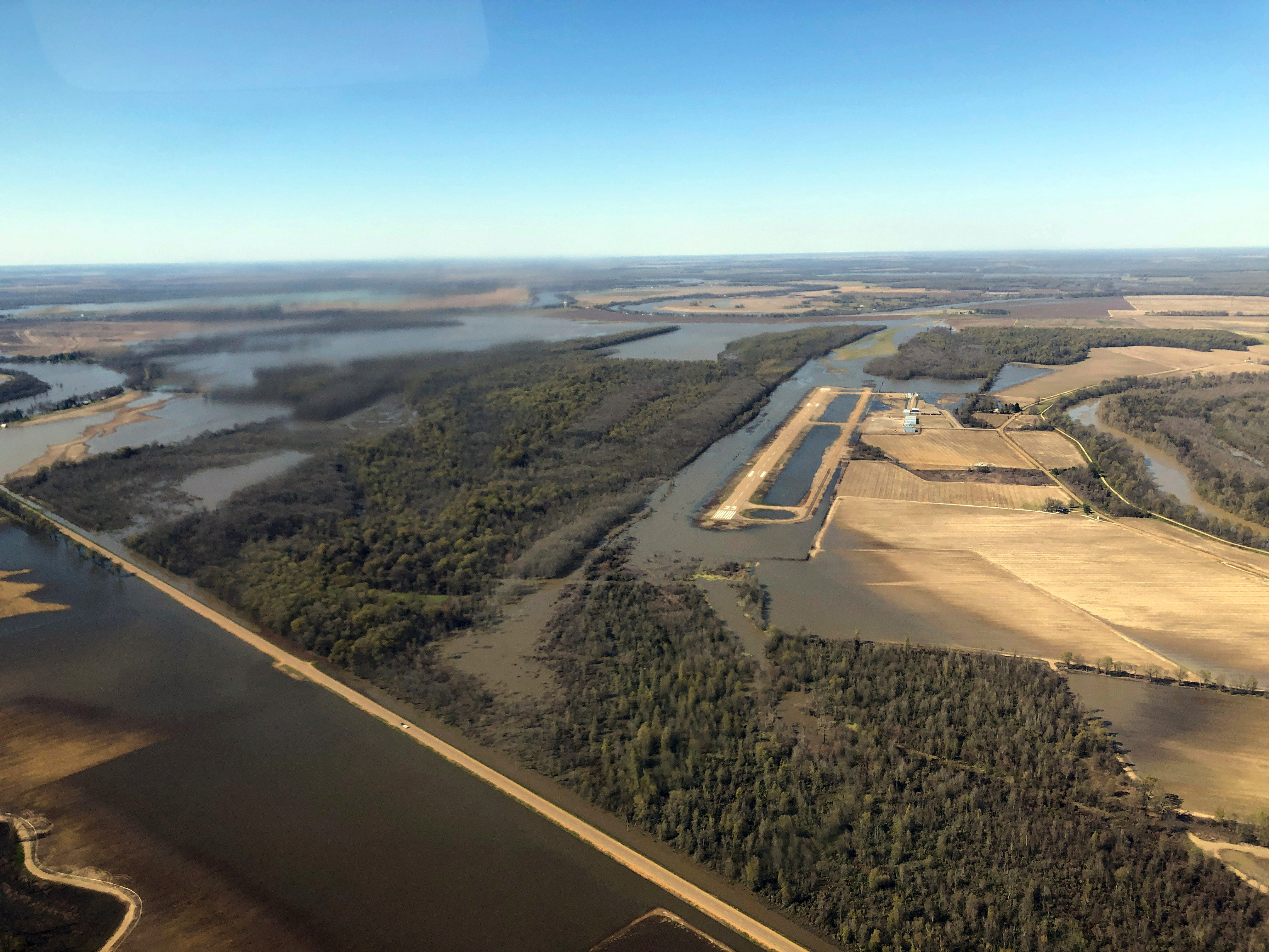 Backwater flooding begins to encircle the Yazoo City, Miss., airport., Sunday, March 17, 2019, as seen in this aerial photograph. Various communities in the Mississippi Delta are combatting both Mississippi River flooding and backwater flooding that are affecting homes, businesses and farm lands.