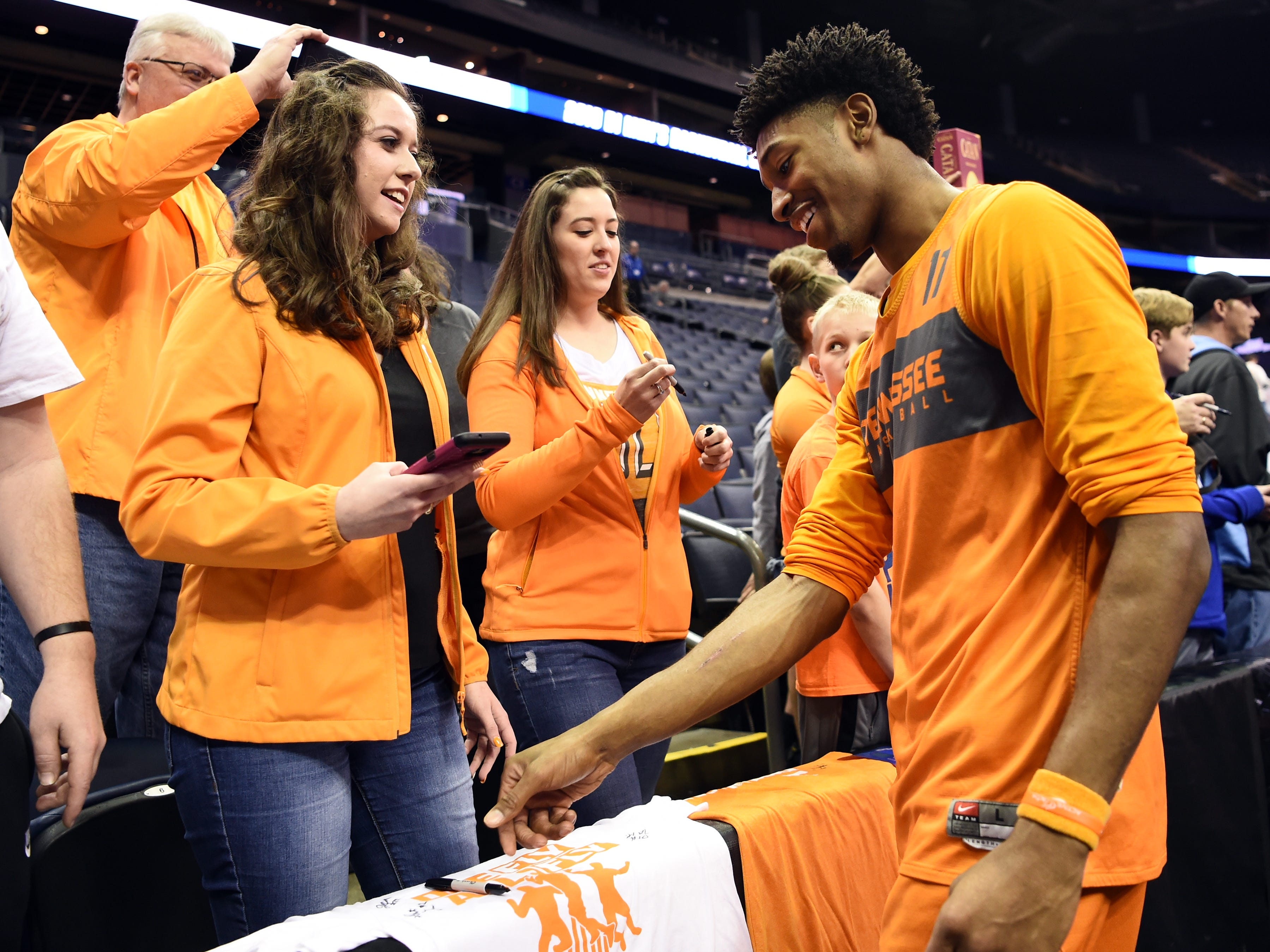 Tennessee forward Kyle Alexander (11) signs items for fans after Tennessee's practice on Thursday, March 21, 2019, before their first round NCAA Tournament game against Colgate at Nationwide Arena in Columbus, Ohio.