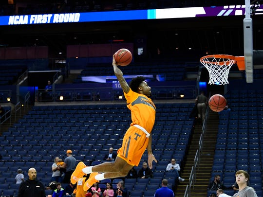 Tennessee guard Jordan Bowden (23) dunks the ball during Tennessee's practice on Thursday, March 21, 2019, before their first round NCAA Tournament game against Colgate at Nationwide Arena in Columbus, Ohio.