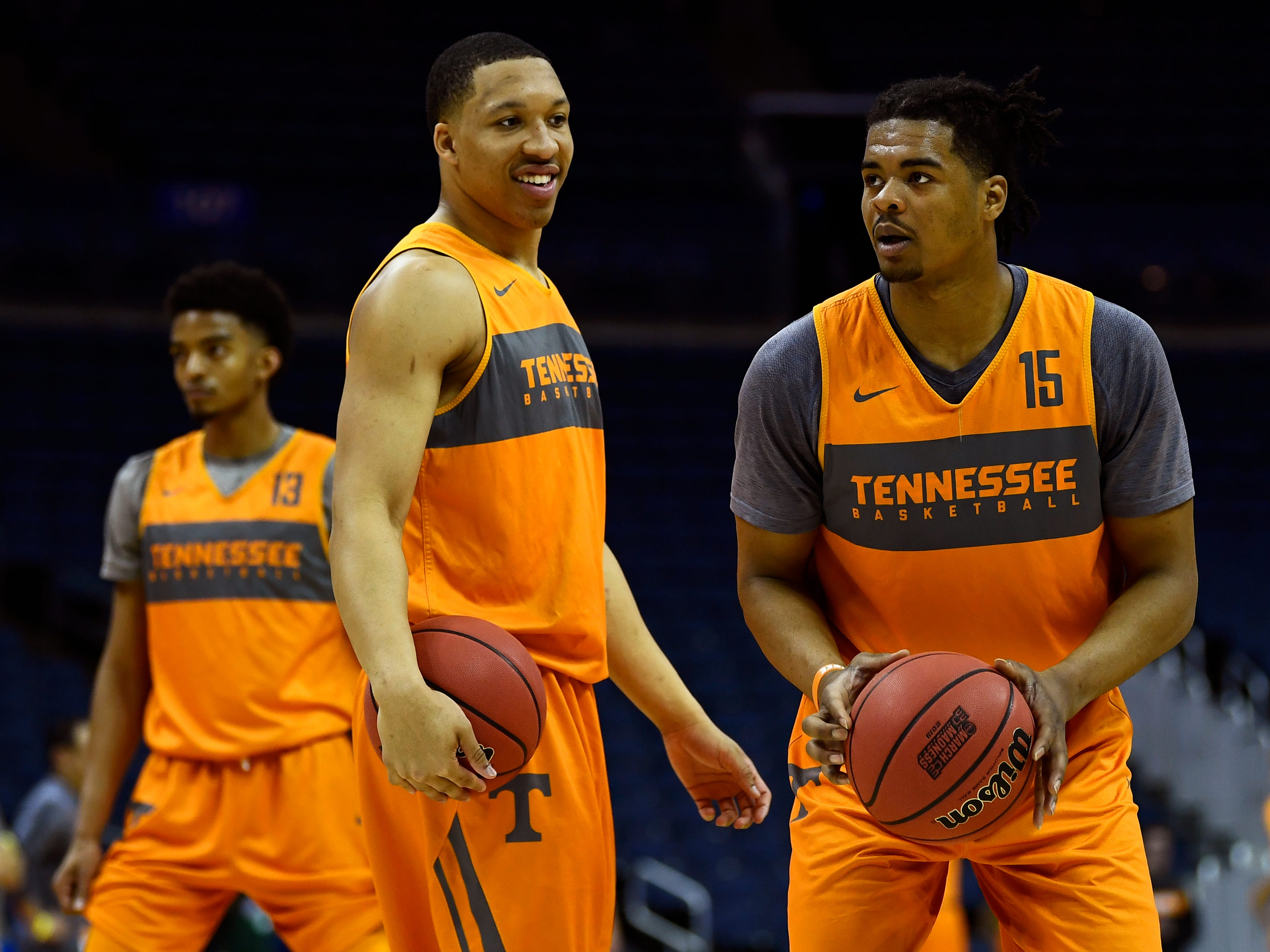 Tennessee forward Grant Williams (2)smiles at Tennessee forward Derrick Walker (15) as he shoots the ball during Tennessee's practice on Thursday, March 21, 2019, before their first round NCAA Tournament game against Colgate at Nationwide Arena in Columbus, Ohio.