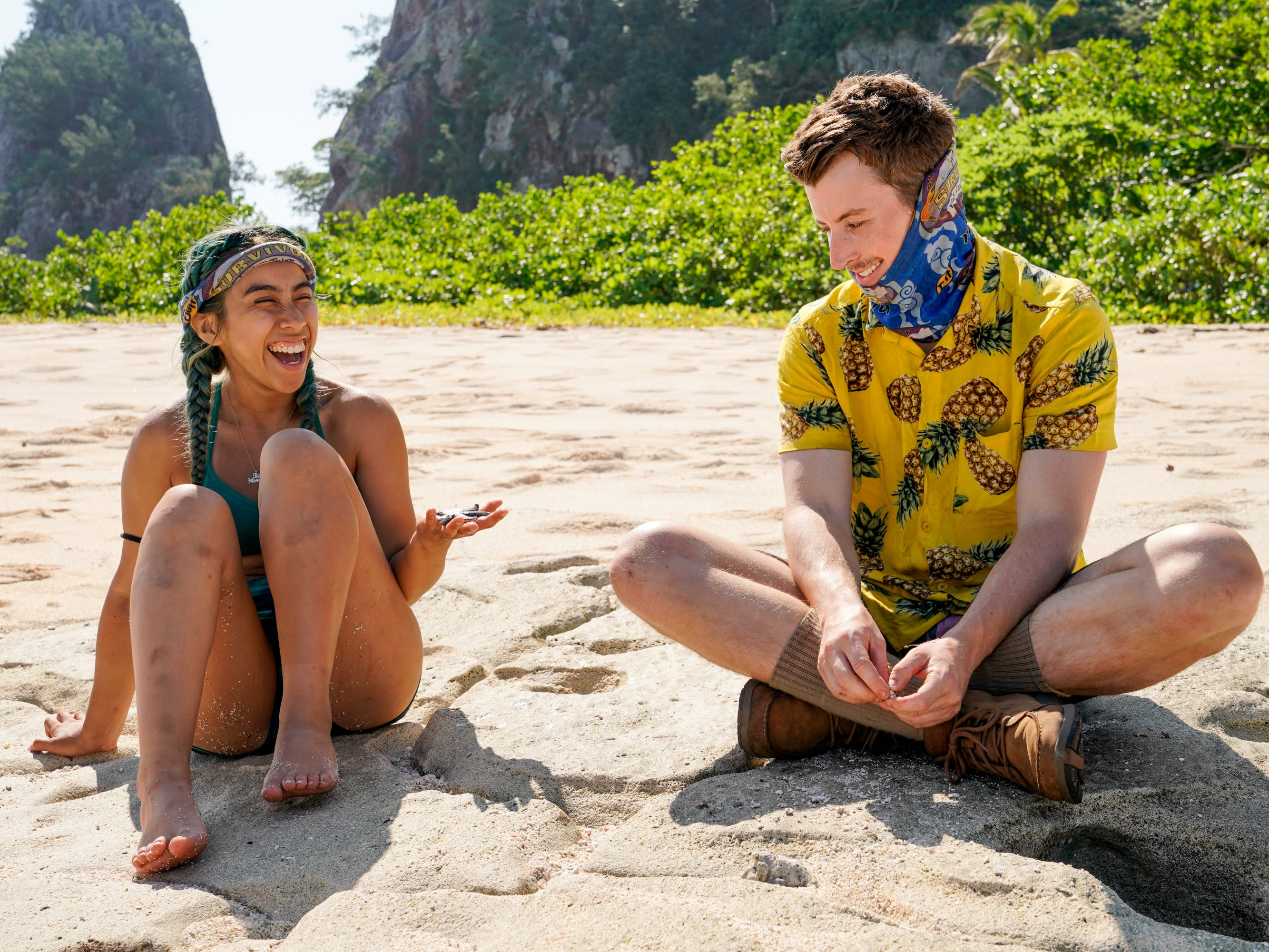 "Wendy Diaz and Gavin Whitson sit together on ""Survivor: Edge of Extinction."""