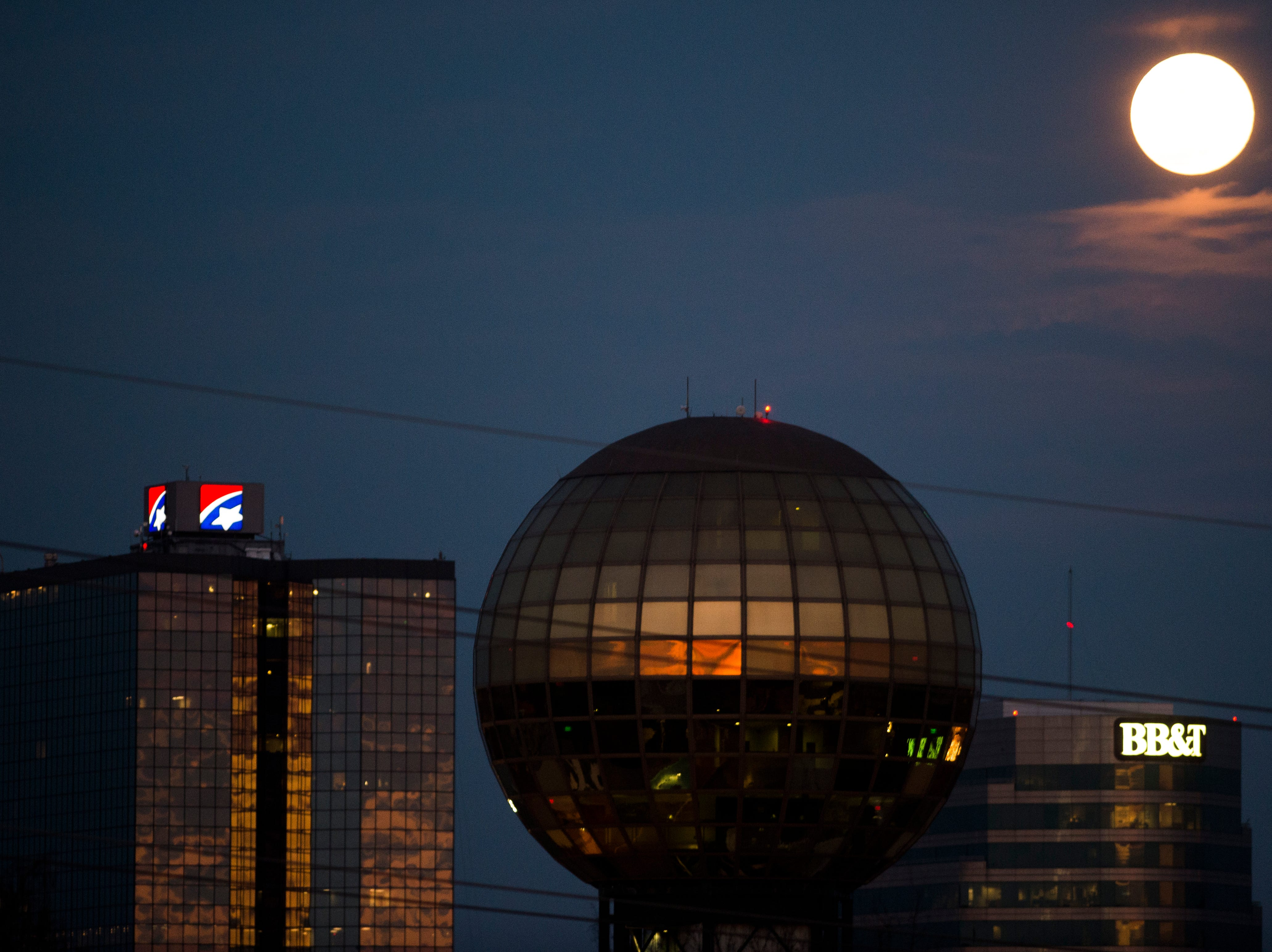 A 'super worm equinox moon' rises over downtown as seen from Fort Sanders in Knoxville, Tennessee on Wednesday, March 20, 2019. The last supermoon of 2019 gets its name since it coincides with the spring equinox and folklore where it says as the frosty ground melts, earthworms begin emerging.