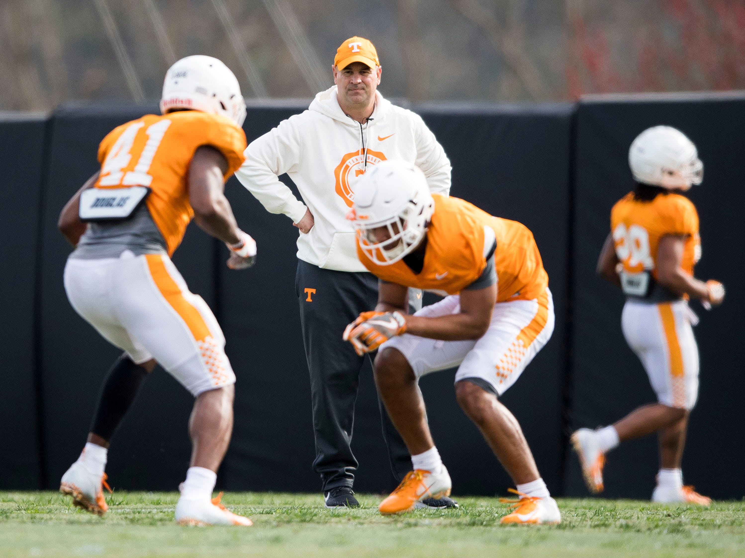 Tennessee head coach Jeremy Pruitt watches defensive backs Kenneth George Jr. (41) and Romello Edwards (7) during Tennessee's afternoon football practice on Monday, March 11, 2019.