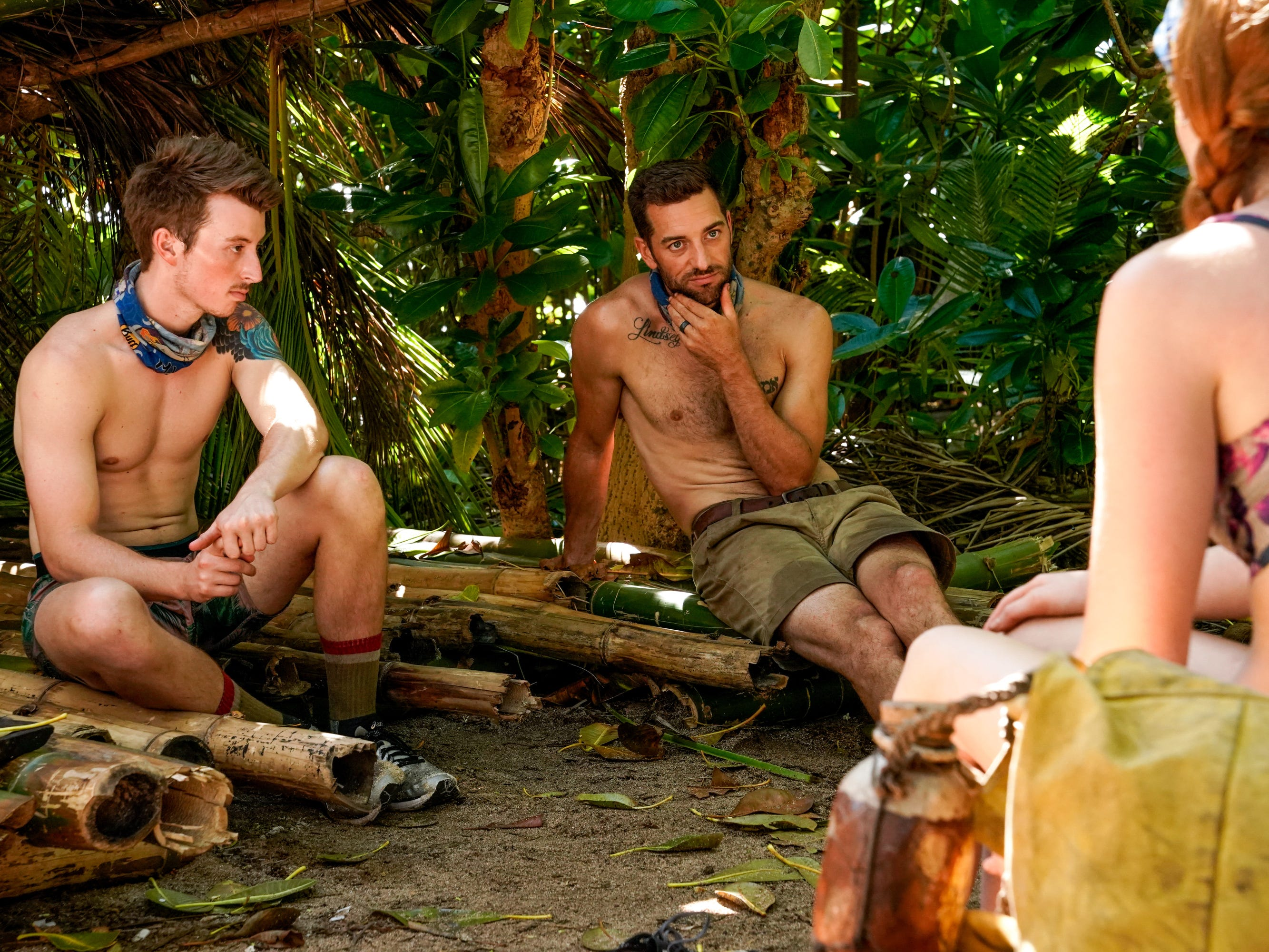 "Gavin Whitson and Eric Hafemann sit together on ""Survivor: Edge of Extinction."""