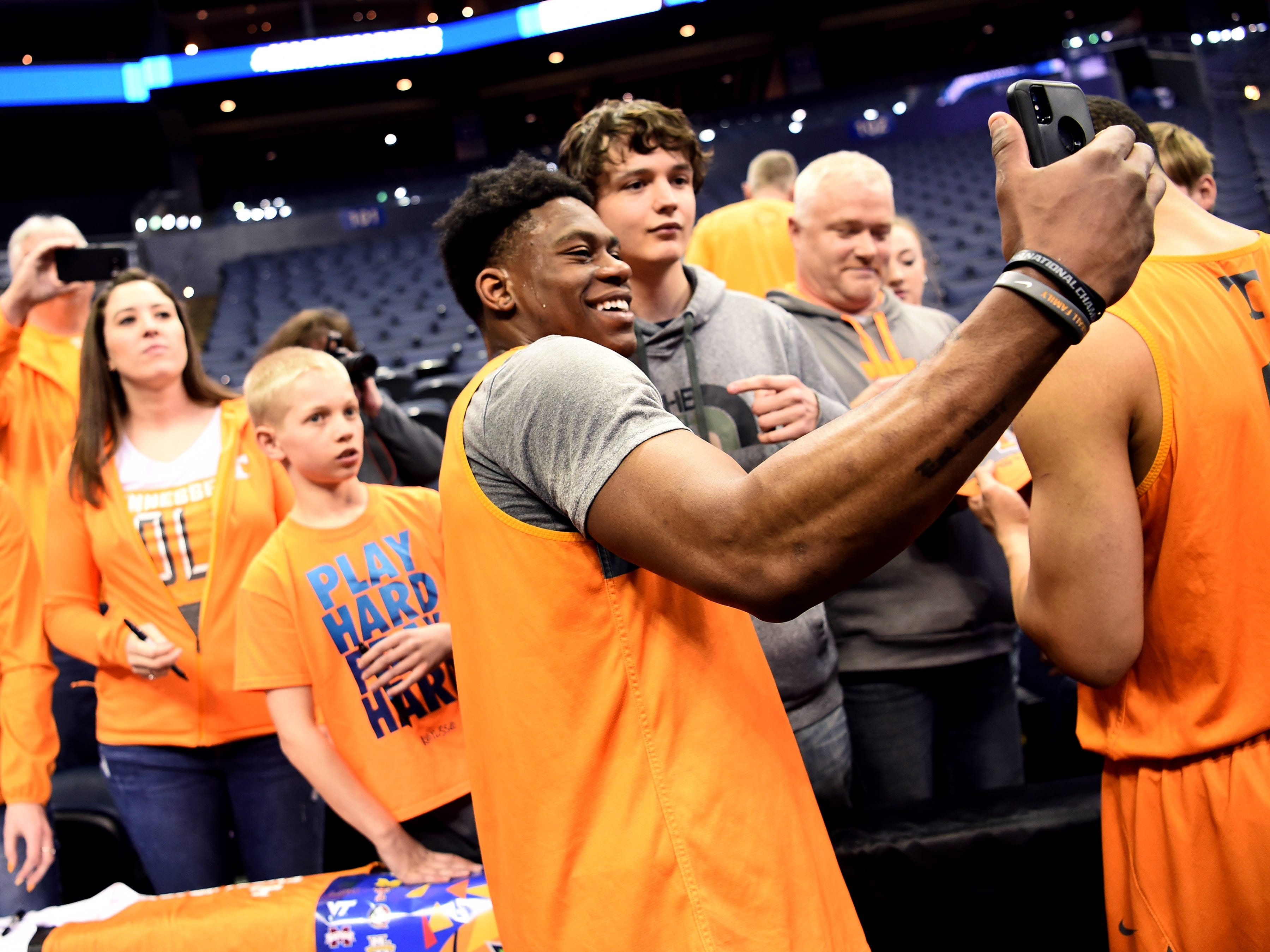Tennessee guard Admiral Schofield (5) takes a selfie with a fan after Tennessee's practice on Thursday, March 21, 2019, before their first round NCAA Tournament game against Colgate at Nationwide Arena in Columbus, Ohio.