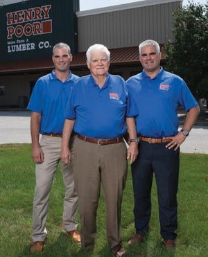 Henry Poor Lumber Co CEO Jim Andrew, middle, stands outside the Brady Lane facilities with sons Tom Andrew, left, and Jay Andrew, right.