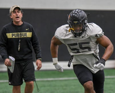 Purdue linebacker Derrick Barnes works on technique under the watchful eye of assistant coach Kevin Wolthausen during spring football in West Lafayette on Wednesday March 20, 2019.