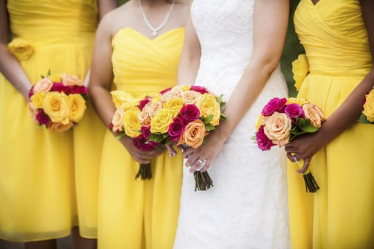 It?s a rare bride who doesn?t have a regret or two about her wedding. Getty Images/iStockphoto Bride Holding Bouquet with Bridesmaids in Background