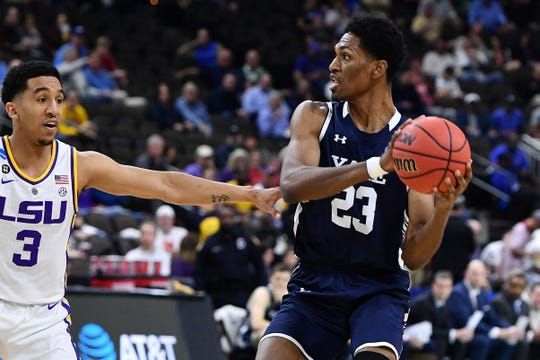 Mar 21, 2019; Jacksonville, FL, USA; Yale Bulldogs forward Jordan Bruner (23) controls the ball against LSU Tigers guard Tremont Waters (3) during the first half in the first round of the 2019 NCAA Tournament at Jacksonville Veterans Memorial Arena. Mandatory Credit: John David Mercer-USA TODAY Sports