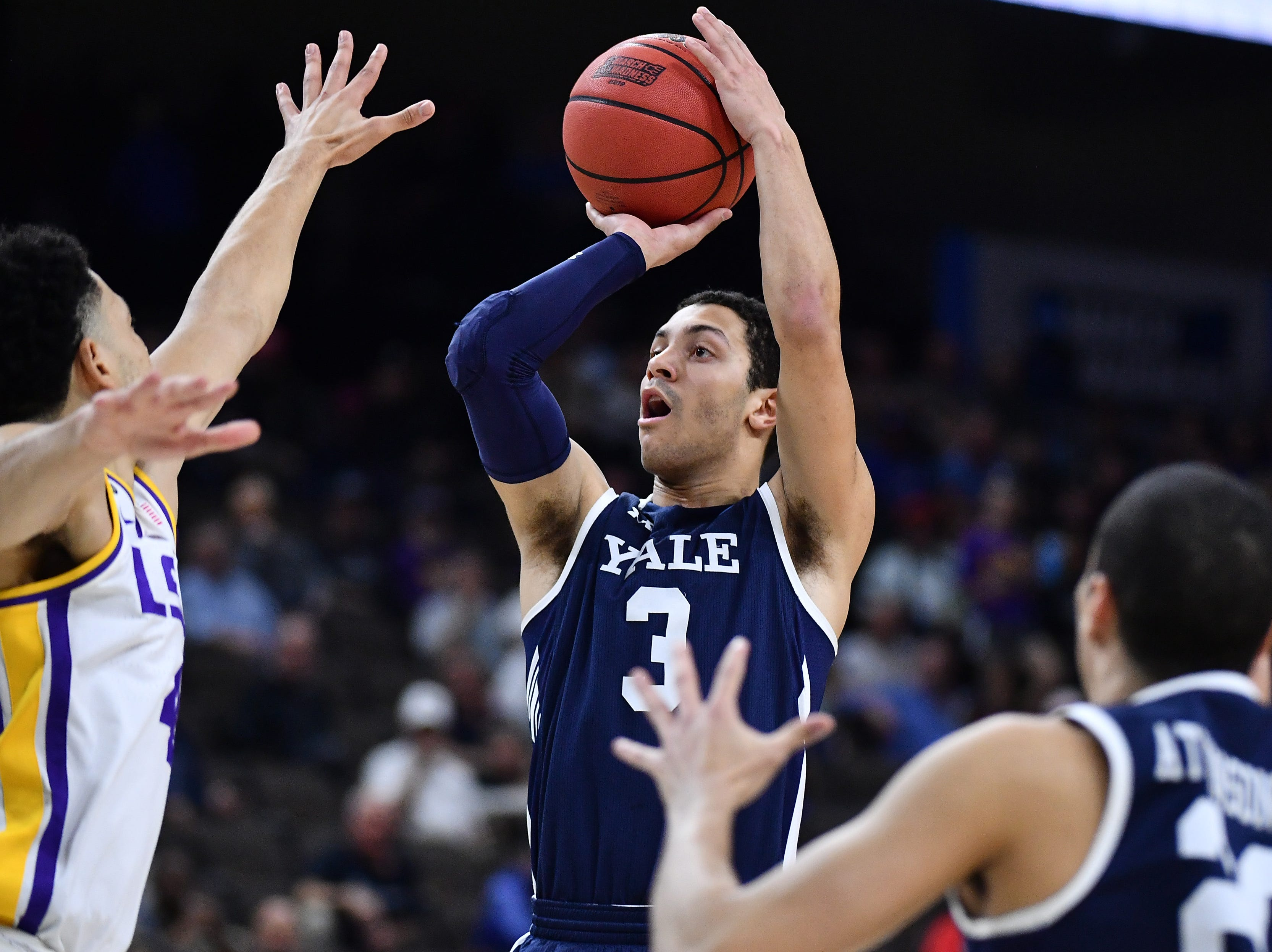 Mar 21, 2019; Jacksonville, FL, USA; Yale Bulldogs guard Alex Copeland (3) shoots against LSU Tigers guard Skylar Mays (left) during the first half in the first round of the 2019 NCAA Tournament at Jacksonville Veterans Memorial Arena. Mandatory Credit: John David Mercer-USA TODAY Sports