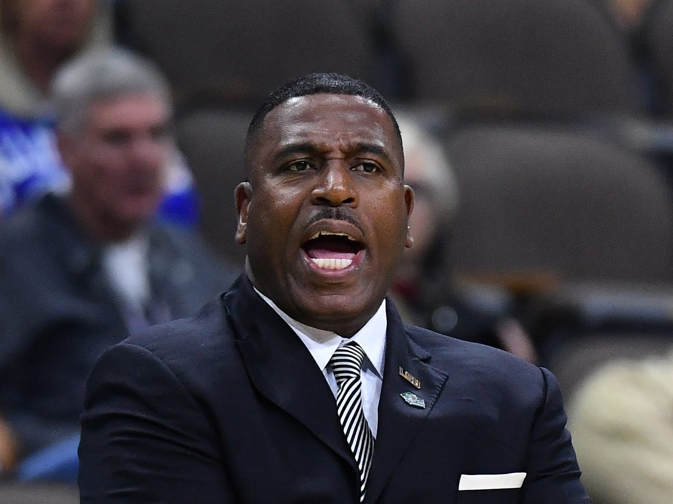 Mar 21, 2019; Jacksonville, FL, USA; LSU Tigers interim head coach Tony Benford calls out to his players during the first half against the Yale Bulldogs in the first round of the 2019 NCAA Tournament at Jacksonville Veterans Memorial Arena. Mandatory Credit: John David Mercer-USA TODAY Sports