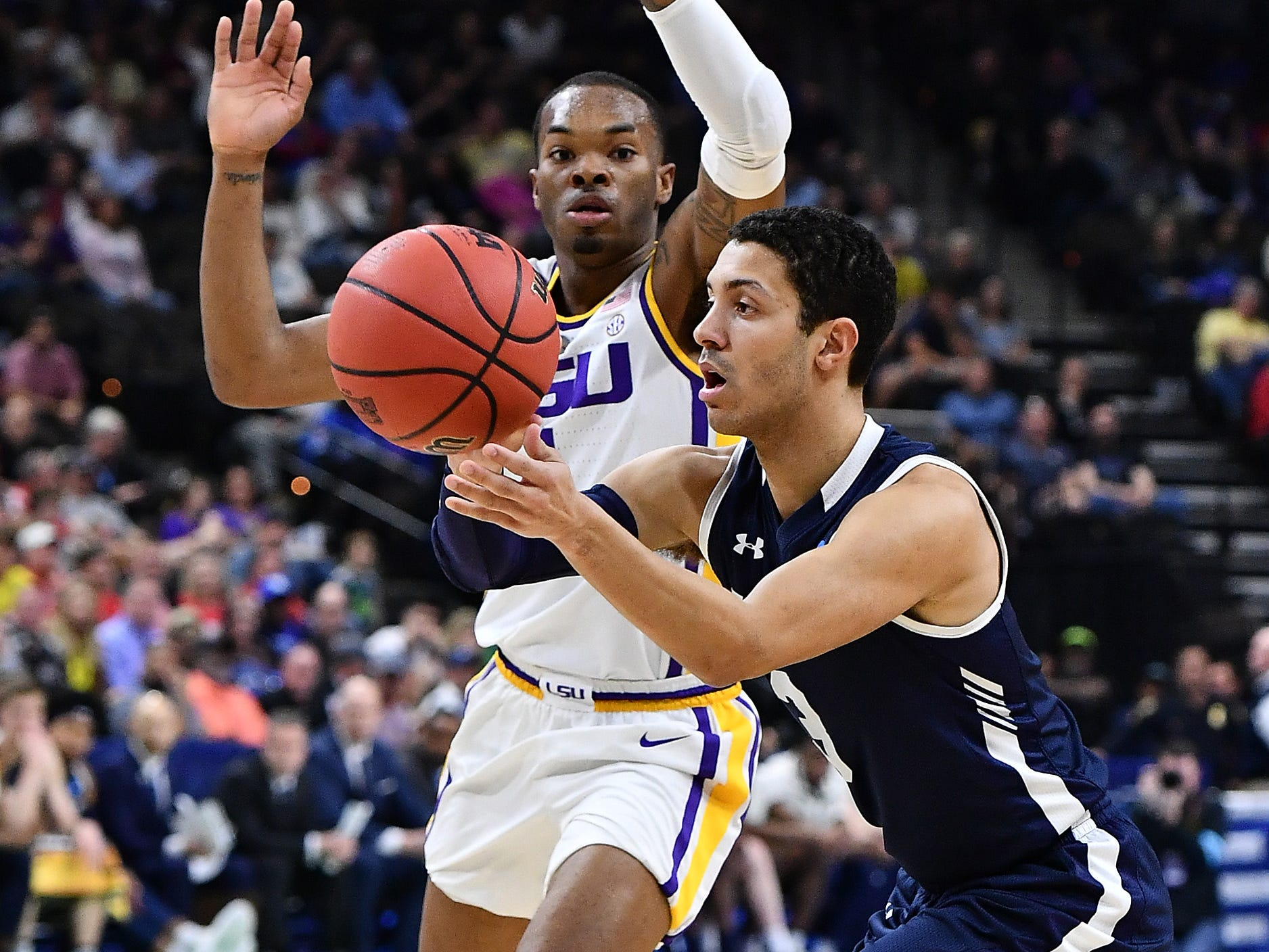Mar 21, 2019; Jacksonville, FL, USA; Yale Bulldogs guard Alex Copeland (3) passes the ball against LSU Tigers guard Javonte Smart (1) during the first half in the first round of the 2019 NCAA Tournament at Jacksonville Veterans Memorial Arena. Mandatory Credit: John David Mercer-USA TODAY Sports