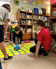 Fourth-graders in Woodvale Elementary's Robotics Club put their Dash and Dot Robots to the test and show their families what they've been working on for six weeks Tuesday, March 19. They present their projects in teams.
