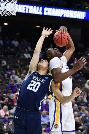 Mar 21, 2019; Jacksonville, FL, USA; LSU Tigers forward Kavell Bigby-Williams (11) grabs a rebound over Yale Bulldogs forward Paul Atkinson (20) during the first half in the first round of the 2019 NCAA Tournament at Jacksonville Veterans Memorial Arena. Mandatory Credit: John David Mercer-USA TODAY Sports