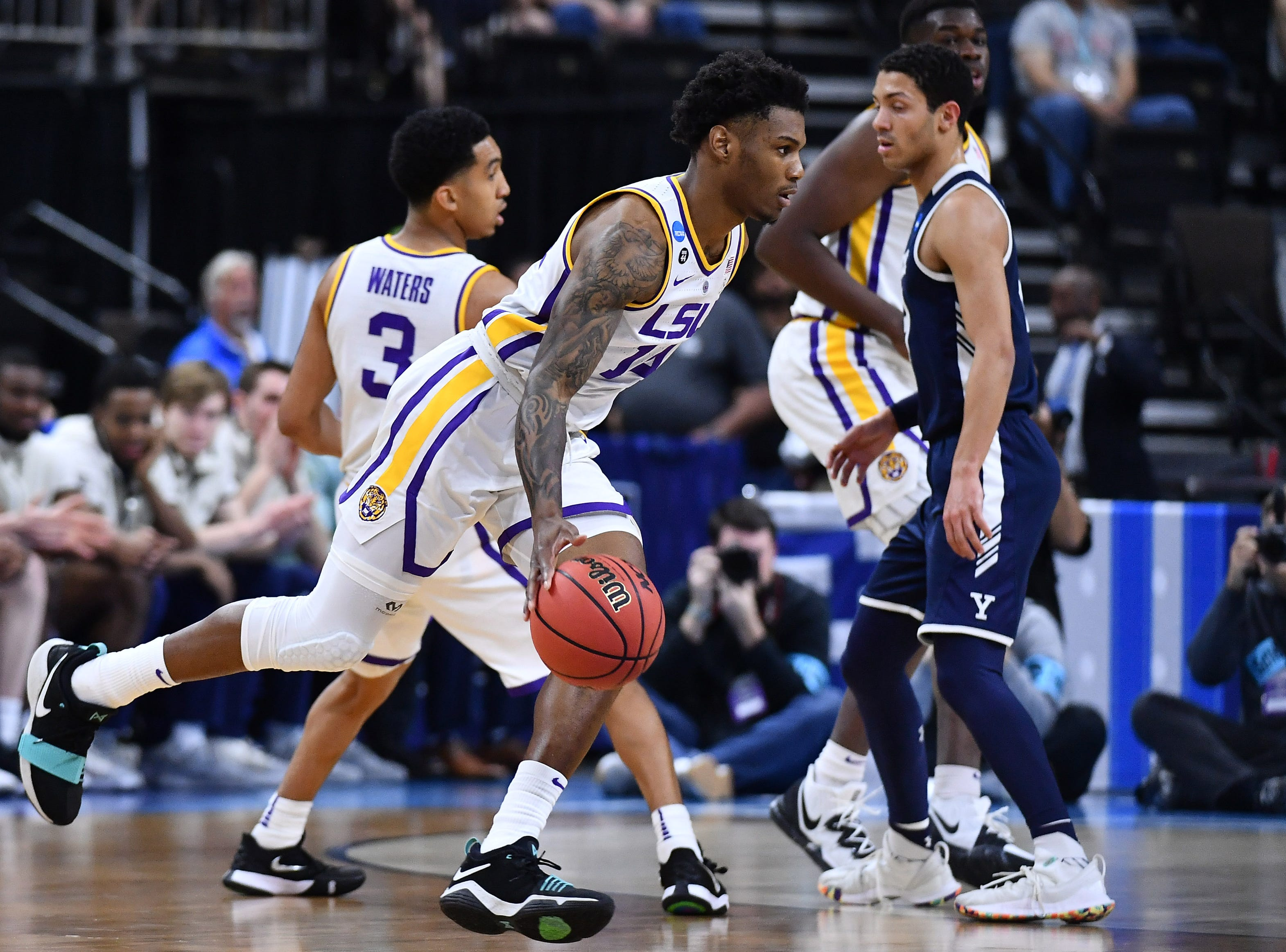 Mar 21, 2019; Jacksonville, FL, USA; LSU Tigers guard Marlon Taylor (14) dribbles the ball against the Yale Bulldogs during the first half in the first round of the 2019 NCAA Tournament at Jacksonville Veterans Memorial Arena. Mandatory Credit: John David Mercer-USA TODAY Sports