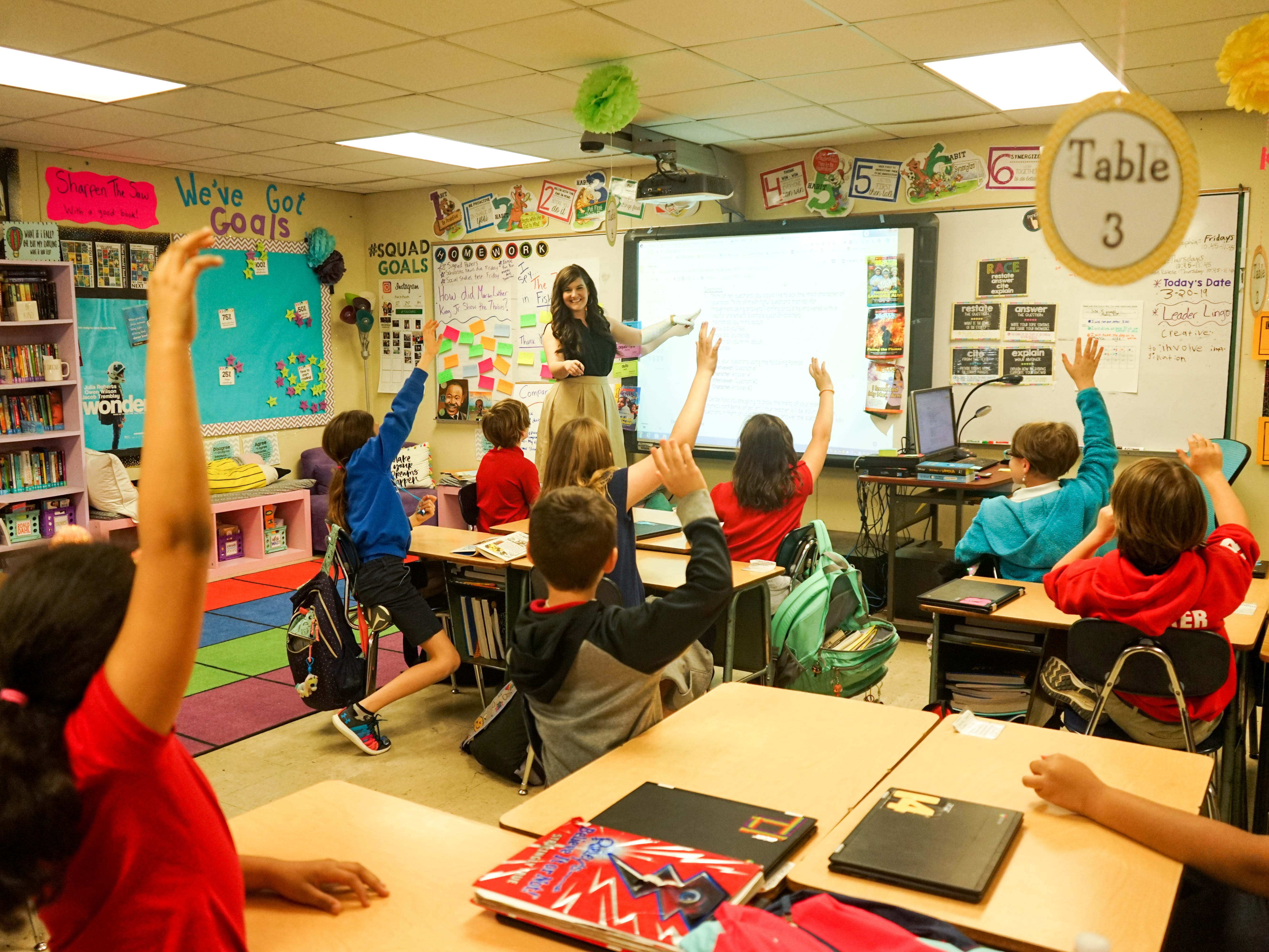 Twin sisters Taylor Wallace and Morgan Mercado share the same love for teaching at Woodvale Elementary School in Lafayette, Louisiana. Here, Mercado teachers her fourth-graders.