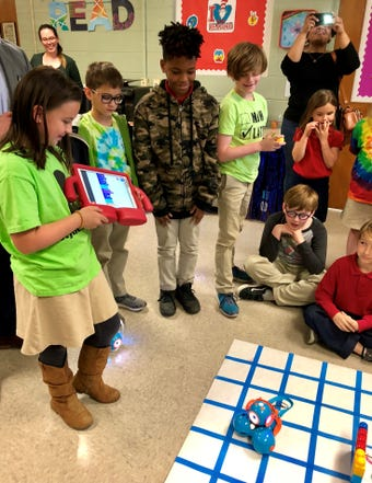Woodvale Elementary started a robotics club this year. Fourth-graders programmed Dash Robots to solve a problem and presented Tuesday.