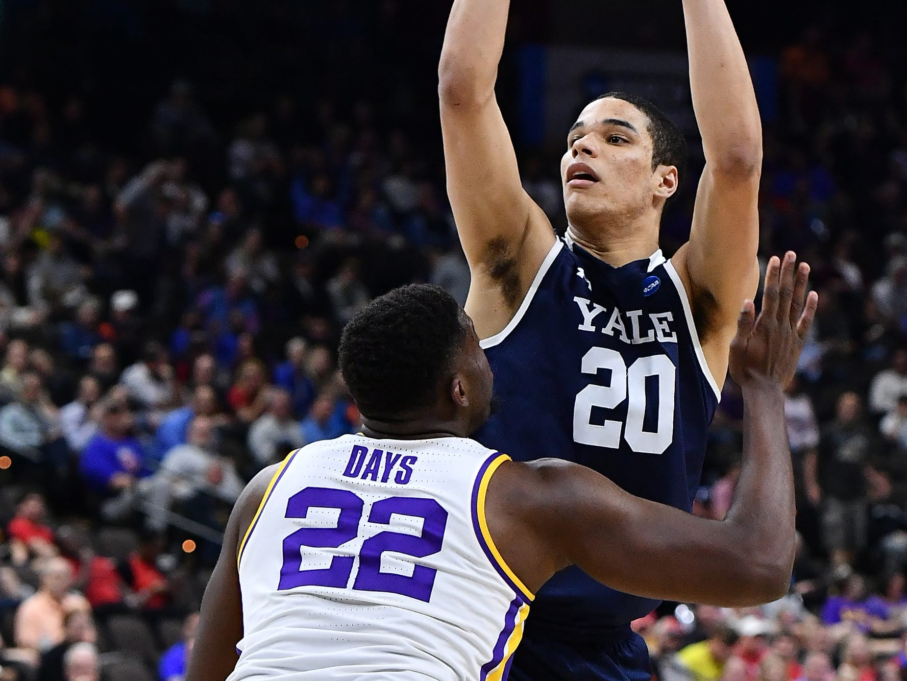 Mar 21, 2019; Jacksonville, FL, USA; Yale Bulldogs forward Paul Atkinson (20) shoots over LSU Tigers forward Darius Days (22) during the second half in the first round of the 2019 NCAA Tournament at Jacksonville Veterans Memorial Arena. Mandatory Credit: John David Mercer-USA TODAY Sports