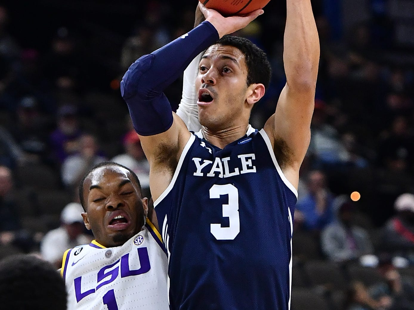 Mar 21, 2019; Jacksonville, FL, USA; Yale Bulldogs guard Alex Copeland (3) shoots against LSU Tigers guard Javonte Smart (1) during the first half in the first round of the 2019 NCAA Tournament at Jacksonville Veterans Memorial Arena. Mandatory Credit: John David Mercer-USA TODAY Sports