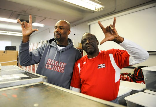 Lloyd Darby, left, and the late Leonard Wiltz, right, have devoted years of serve to the UL athletic program. Wiltz will be laid to rest Saturday.