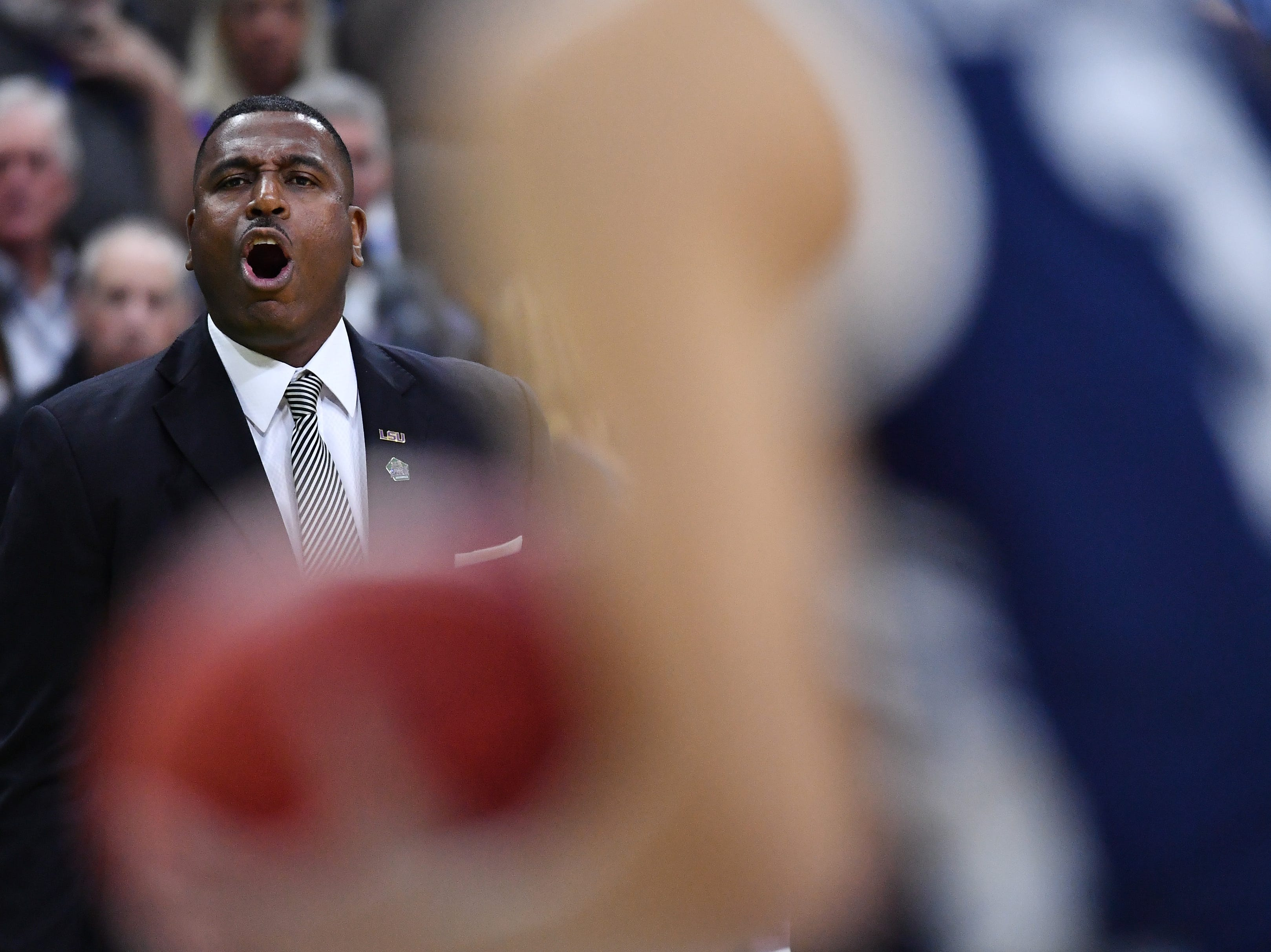 Mar 21, 2019; Jacksonville, FL, USA; LSU Tigers interim head coach Tony Benford reacts during the first half against the Yale Bulldogs in the first round of the 2019 NCAA Tournament at Jacksonville Veterans Memorial Arena. Mandatory Credit: John David Mercer-USA TODAY Sports