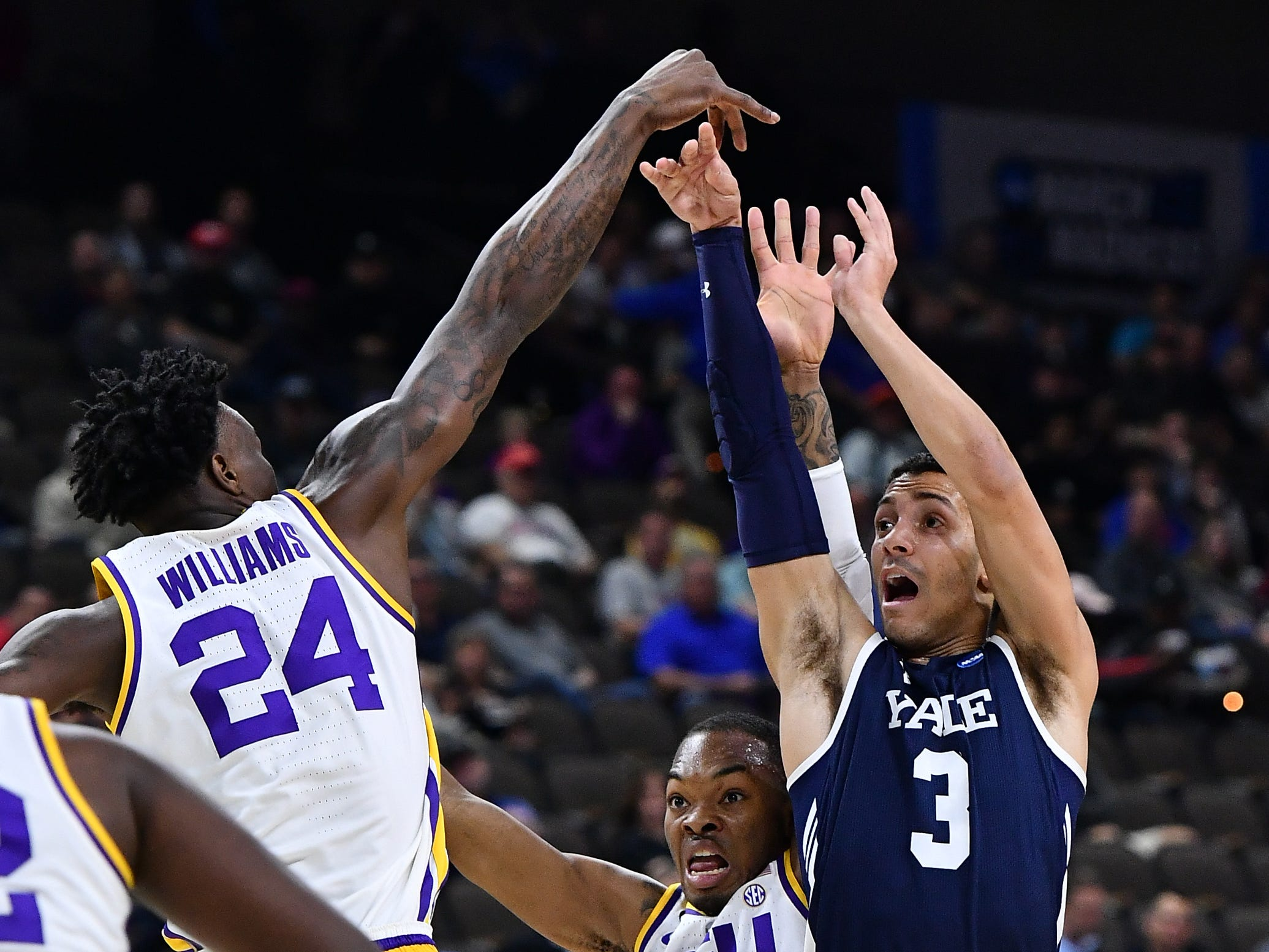Mar 21, 2019; Jacksonville, FL, USA; LSU Tigers forward Emmitt Williams (24) blocks a shot by Yale Bulldogs guard Alex Copeland (3) as LSU guard Javonte Smart (1) assists during the first half in the first round of the 2019 NCAA Tournament at Jacksonville Veterans Memorial Arena. Mandatory Credit: John David Mercer-USA TODAY Sports