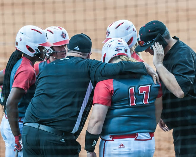 Cajuns head softball coach Gerry Glasco meets with this team to try to break the tie score as the UL Ragin' Lady Cajuns play the McNeese Cowgirls at Lamson Park on Wednesday, March 20, 2019.