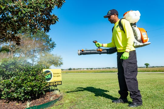 Mosquito Joe Technician Damien Williams treating yard for Mosquitos. Thursday, March 21, 2019.